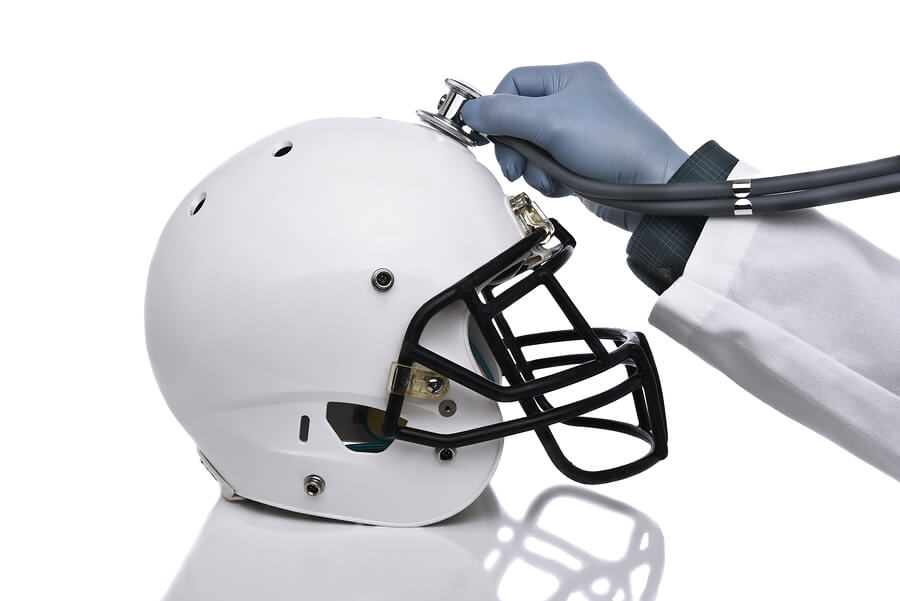 A doctor with a stethoscope and a football helmet.