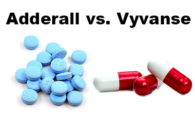 adderall pills and vyvanse pills on a white background