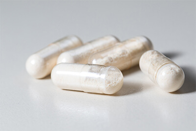 Bunch of probiotics capsules on white background