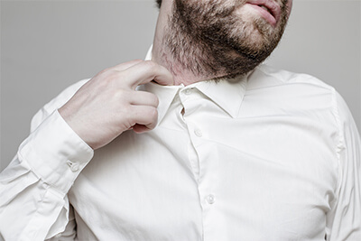 Save Download Preview The unshaven man in the white shirt is tight and stuffy and he tries to expand the collar to make a breath
