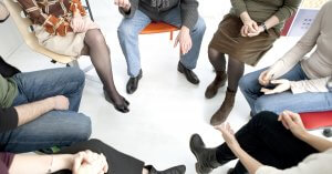 people in group therapy session in rhode island