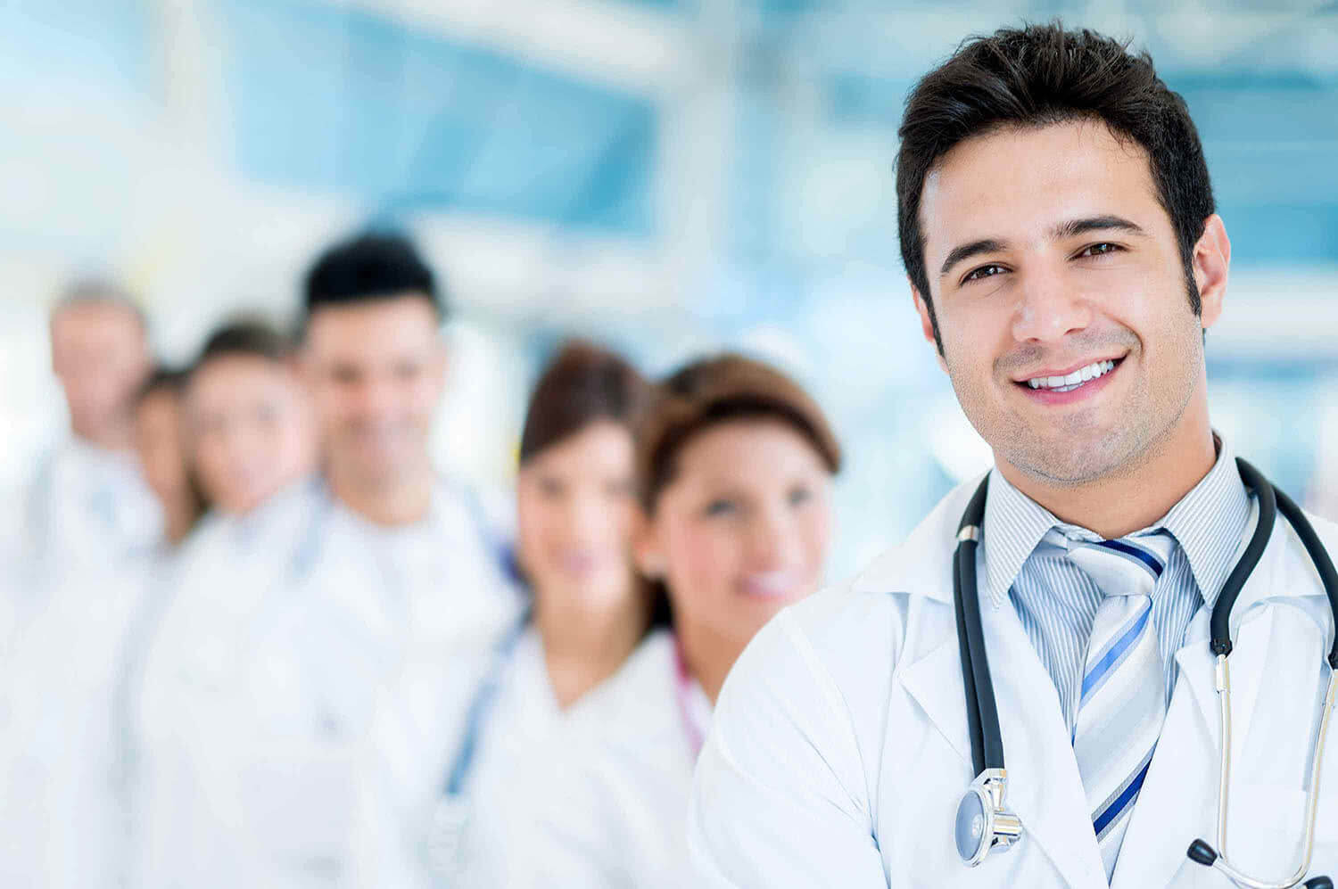 Male doctor at the hospital with his team